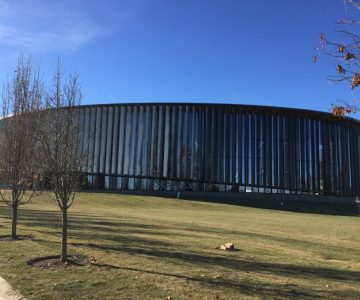 Glass welding splatter repair College building | Glass Restoration Guru